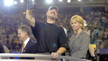 Steelers coach Bill Cowher celebrates beside his wife Kaye after beating Seattle for the Super Bowl title.
