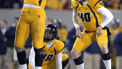 West Virginia kicker Pat McAfee and Mark Magro (53) react after McAfee misses his second field goal of the first half against Pitt.