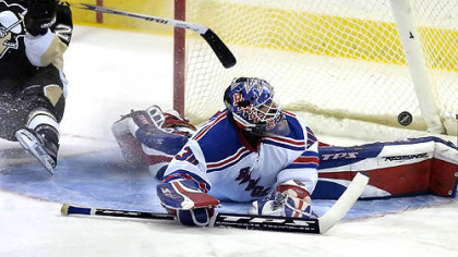 Maxime Talbot slides past the net as the puck sails over the pads of Rangers goalie Henrik Lundqvist in the first period Saturday night. Talbot's goal was his fifth of the season. (vs. Rangers 11/17/07)