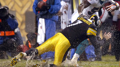 Quarterback Ben Roethlisberger brings down former teammate Joey Porter, now Dolphins' linebacker, after he intercepted a pass in the first quarter of last night's water-logged game at Heinz Field. (vs. Dolphins 11/26/07)