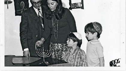 Cookbook author Judy Bart Kancigor, her husband, Barry, and sons Brad, left, and Stu on the first night of Hanukkah, 1970.