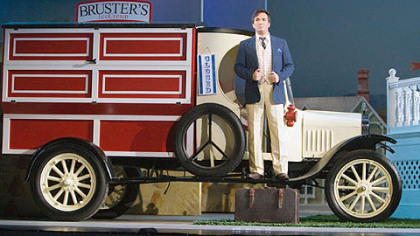 "Tenor John Nuzzo stands on a truck with a Bruster's Ice Cream logo during a performance of the Pittsburgh Opera's production of ""The Elixir of Love"" at the Benedum Center."