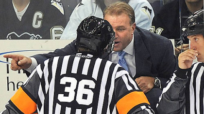 Penguins head coach Michel Therrien argues with referee Dean Morton.