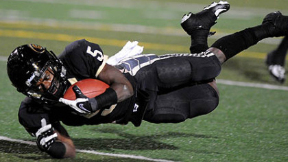 Gateway's Cameron Saddler dives into the end zone for the Gators' first touchdown in the first quarter against Penn Hills last night.