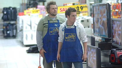 "Bret Harrison, right, and Tyler Labine don Work Bench aprons in ""Reaper."""