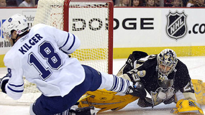 Marc-Andre Fleury makes save against the Leafs Chad Kilger.