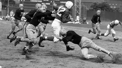 Marshall Goldberg, the former Pitt All-America who played for the Chicago Cardinals in the NFL, runs through Steelers tacklers at Forbes Field in 1940.