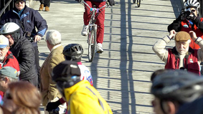 Pedestrians and bikers make their way across the Hot Metal Bridge yesterday.