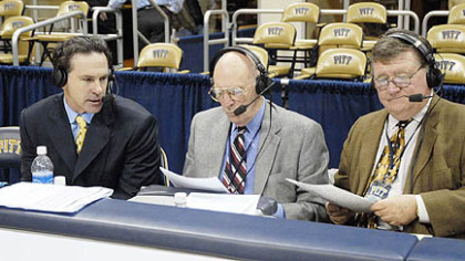 Dick Groat, center, and Bill Hillgrove do a post-game interview with Pitt coach Jamie Dixon, left.