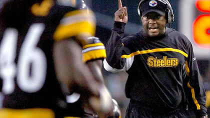 Tomlin keeps an eye on his team.