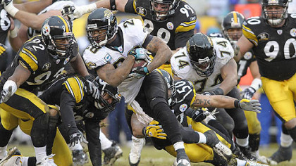 Jaguars running back Fred Taylor picks up a first down against the Steelers in the second half. (vs. Jaguars 12/16/2007)