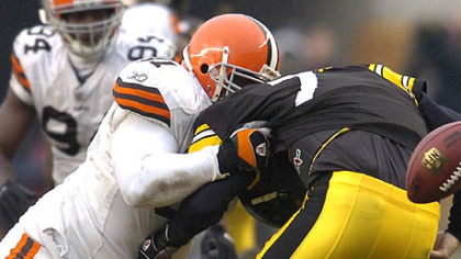 Quarterback Ben Roethlisberger loses the football as he's taken down by Browns' defensive end Shaun Smith in the third quarter. (vs. Browns 11/11/07)