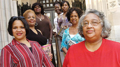 Seven members of the monthly reading group Sisters That Are Readers (STARS) gather at the Homewood Library. Clockwise from bottom left, are Nichole Jordan, M. Gayle Moss, Mercedes Taylor, Velma Harris, Denice Coker, Vivian Shelton and Donna Stilo.