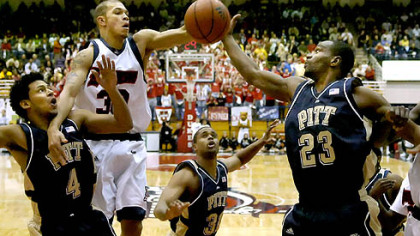 From left, Pitt's Ronald Ramon, Mike Cook and Sam Young fight under the basket for a rebound against Duquesne's Bill Clark last night at the Palumbo Center. Pitt won, 73-68. (at Dukes 12/05/2007)