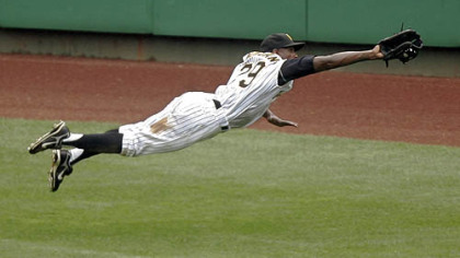 Center fielder Nyjer Morgan makes a diving catch of a fly ball hit by the Cubs' Aramis Ramirez in the third inning yesterday at PNC Park.
