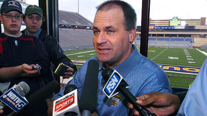 West Virginia football coach Rich Rodriguez speaks to the media at a morning news conference Saturday at Milan Puskar Stadium in Morgantown, W.Va., but refused to address reports that he was a candidate for the University of Michigan job.