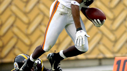 Defensive back Anthony Madison tries to tackle Browns wide receiver Joshua Cribbs as he runs a kickoff back 90 yards to the Steelers 3. (vs. Browns 11/11/07)