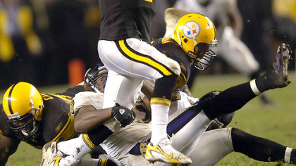 Steelers quarterback Ben Roethlisberger scrambles as he tries to avoid a sack in the second quarter.(vs. Ravens 11/05/07)