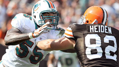 Miami Dolphins linebacker Joey Porter is blocked by the Browns' Steve Heiden yesterday in Cleveland.