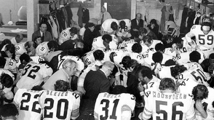 Steelers owner Art Rooney, center in dark suit, joins his team in prayer in the dressing room after they won Super Bowl IX in New Orleans over the Minnesota Vikings, 16-6.
