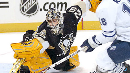 Marc-Andre Fleury makes a save on the Maple Leafs' Chad Kilger in the first period.