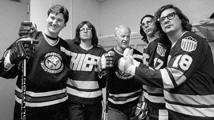 "The ""Hanson Brothers"" of ""Slap Shot"" fame pose with Mario Lemieux, left, and NHL legend Gordie Howe in 1995."