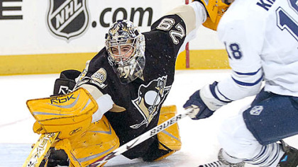 Penguins Marc-Andre Fleury makes save on Leafs Chad Kilger in the first period.