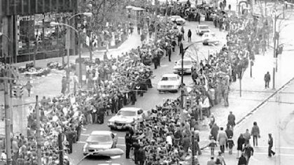 Police cars lead the Super Bowl IX champion Steelers through Gateway Center and down to Liberty Ave.