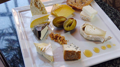 Eleven in the Strip District&#039;s artisan cheese plate includes, starting with the double stacked pieces in upper right and going clockwise: Capriole (Greenville, Ind.) Old Kentucky Tomme (goat); Zingerman&#039;s Creamery (Ann Arbor, Mich.) Lincoln Log (goat); Jasper Hill Farm (Greensboro, Vt.) Bayley Hazen Blue (cow); Old Chatham (N.Y.) Sheepherding Co. Camembert (sheep); Capriole O&#039;Bannon (goat); Bellwether Farms (Sonoma, Calif.) Carmody (cow); Hendricks Farms and Dairy (Telford, Pa.) Grass Stain (cow); and  Uplands Cheese Co. (Dodgeville, Wisc.) Pleasant Ridge Reserve (cow).