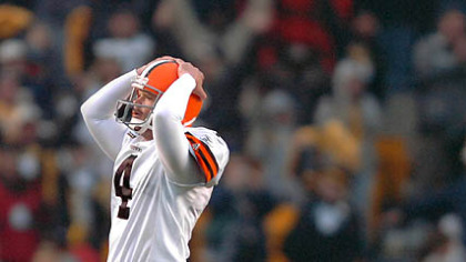 Browns' kicker Phil Dawson holds his helmet after missing a 52-yard game-tying field goal in the closing seconds. (vs. Browns 11/11/07)