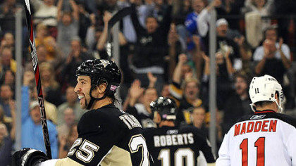 The Penguins' Max Talbot celebrates his goal in the first period against the Devils.