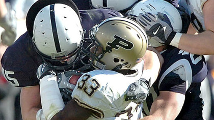 Dan Connor & company gang up on Purdue's Jaycen Taylor on Saturday.