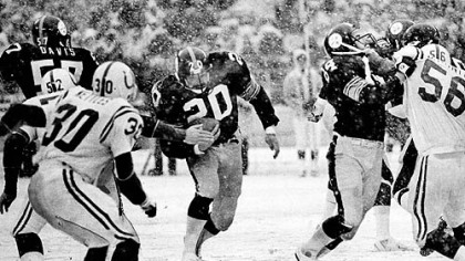 Getting a block from Randy Grossman, 84, Steelers Rocky Bleier charges through a hole for a good gain against Baltimore Colts, 1978.