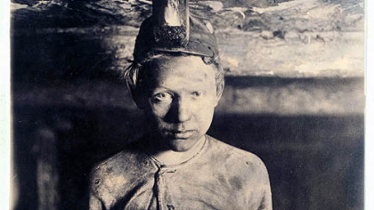 This circa 1908 photograph shows a trapper boy at Turkey Knob Mine in Macdonald, W.Va.  Trapper boys were paid 85 cents a day in Monongah, W.Va., to operate the wooden ventilation doors known as traps that controlled the flow of air inside the mines.