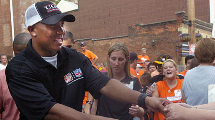 Hines Ward shakes hands with the fans and volunteers from Home Depot, the non-profit organization KaBoom! and other community members who joined forces yesterday to build a playground in Spring Garden.