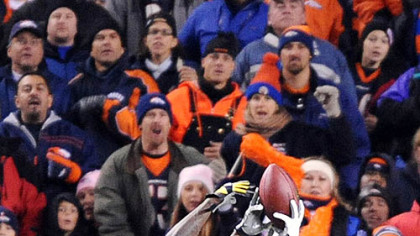 Santonio Holmes has the ball taken away by the Broncos' Dre Bly.