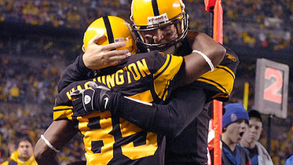Steelers quarterback Ben Roethlisberger celebrates with linebacker Nate Washington after throwing his fourth touchdown of the first half against the Ravens.(vs. Ravens 11/05/07)