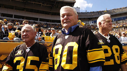 Mr. Butler, center, with fellow Legands Team members Bullet Bill Dudley, left, and Clendon Thomas, right, after being honored at last Sunday's game at Heinz Field.