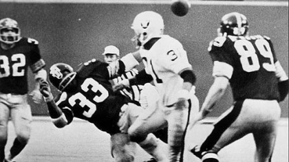 "Franco Harris, far left, sees the ball fly into the air after the Oakland Raiders' Jack Tatum decks the Steelers' Frenchy Fuqua (33), setting up the ""The Immaculate Reception."""