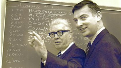 Pittsburgh Steelers owner Art Rooney, left, gestures as he discusses the signing of quarterback Terry Bradshaw, as his son, Dan, looks on in Pittsburgh, in this January 27, 1970 photo.