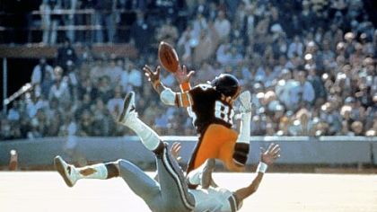 Pittsburgh Steelers Lynn Swann dives as he catches a pass from quarterback Terry Bradshaw during Super Bowl X at the Orange Bowl in Miami, Florida Jan. 18, 1976 against the Dallas Cowboys.