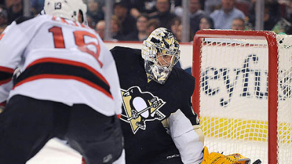 Penguins goalie Marc-Andre Fleury makes a save on the Devils' Dainius Zubrus.