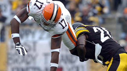 Cornerback Bryant McFadden upends Browns' wide receiver Braylon Edwards as he tries to come up with the ball in the second-quarter. (vs. Browns 11/11/07)