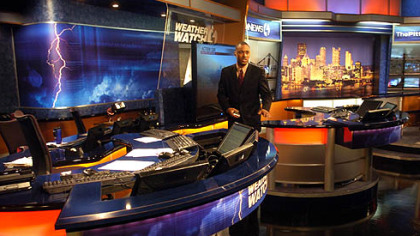 Meteorologist Demetrius Ivory familiarizes himself with WTAE's new studio set, including the two-desk set-up now available for weather reporting.