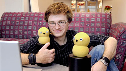 Marek Michalowski, 27, with two of his Keepon robots.