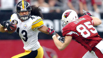 Troy Polamalu picks up a Arizona fumble in the third quarter yesterday at University of Phoenix Stadium in Glendale, Ariz.