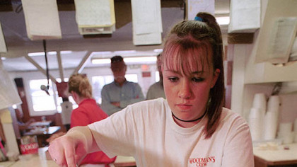 Ashley Eisner, 16, of Essex, Mass., scoops fried clams into a box in the Woodman's restaurant kitchen in Essex. The restaurant is believed to be the home of the original fried clam.