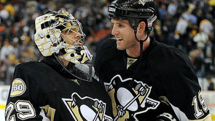Marc-Andre Fleury, left, is congratulated by Ryan Whitney after Fleury shut out the Rangers, 1-0, last night at Mellon Arena.