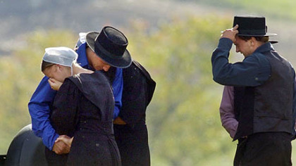 Members of the Nickel Mines Amish community came together to share their sorrow the day after the shooting a year ago that left five girls dead. When the community reached out to the widow and parents of the murderer they sparked a national conversation on the power of forgiveness.