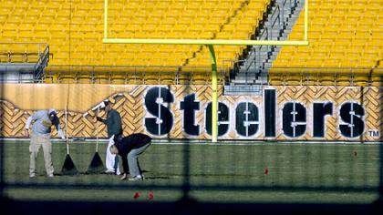 Staff members tend to Heinz Field yesterday to prepare it for Sunday's game with Cincinnati.